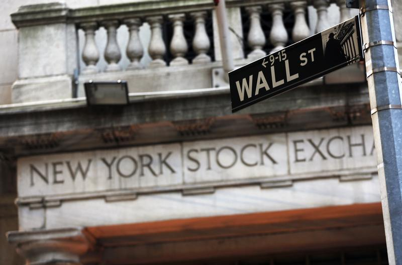Wall Street closes higher after Fed vows more support for the virus-battered economy