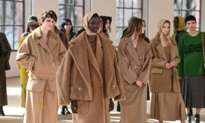 Models gather for the finale of the Max Mara show in Milan.